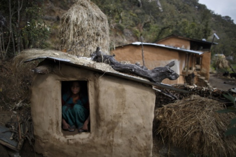 Uttara Saud, 14, during her ?Chaupadi? practice, sits inside the shed where she will spend most of her days and night until her mensuration ends in the hills of Legudsen Village at Achham District